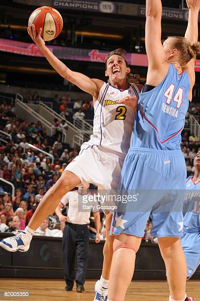 Kelly Miller of the Phoenix Mercury shoots against Katie Feenstra of the Atlanta Dream on July 19 at US Airways Center in Phoenix Arizona NOTE TO...
