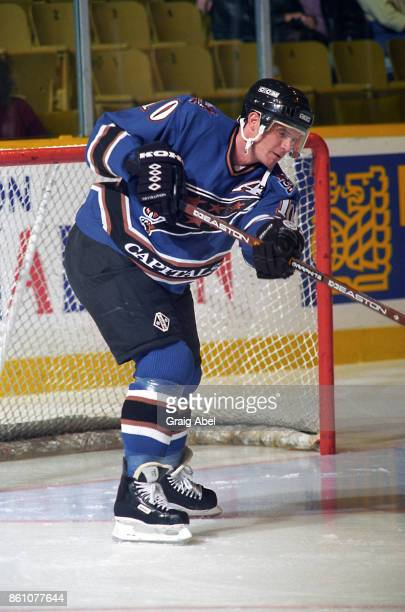 Kelly Miller of the Washington Capitals skates against the Toronto Maple Leafs during NHL game action on November 10 1995 at Maple Leaf Gardens in...