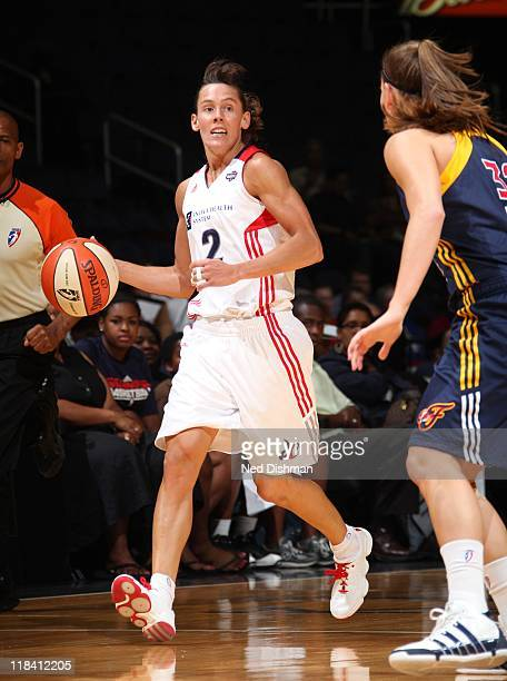 Kelly Miller of the Washington Mystics handles the ball during the game against the Indiana Fever at the Verizon Center on June 21 2011 in Washington...