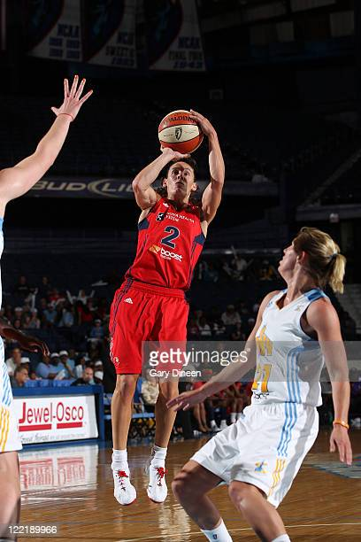 Kelly Miller of the Washington Mystics shoots past Courtney Vandersloot of the Chicago Sky during the WNBA game on August 26 2011 at the AllState...