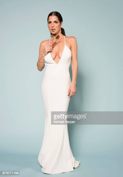 Kelly Monaco poses with Foster Grant Sunglasses at 'Portraits by The Artists Project Sponsored by Foster Grant on' during the 44th Daytime Emmy...
