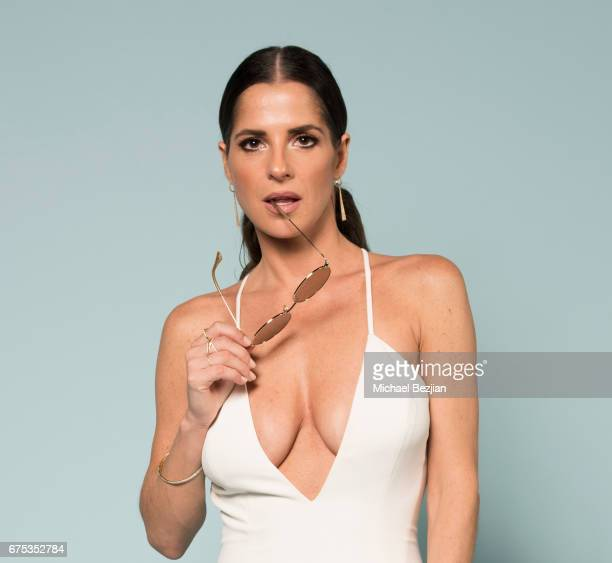 Kelly Monaco poses with Foster Grant Sunglasses at The 44th Daytime Emmy Awards Portraits by The Artists Project Sponsored by Foster Grant on April...