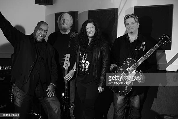 Kelly Moneymaker of the band Expose poses with her new band at the Guitar Center Studios in Woodland Hills California on April 14 2013
