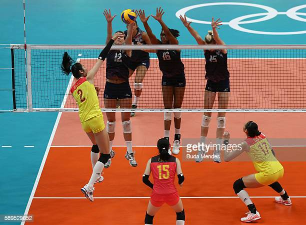 Kelly Murphy Foluke Akinradewo and Kimberly Hill of the United States in action against Ting Zhu of China during the women's qualifying volleyball...