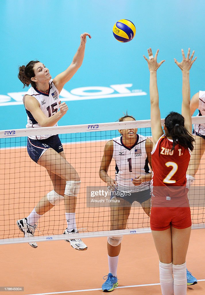 Kelly Murphy of USA spikes the ball during day three of the FIVB World Grand Prix Sapporo 2013 match between China and USA at Hokkaido Prefectural Sports Center on August 30, 2013 in Sapporo, Hokkaido, Japan.