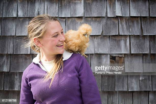 Kelly O'Connell poses for a portrait with her pet Silkie a breed of chicken named Malibu at Wolfe's Neck Farm O'connell originally from Middleburg NY...
