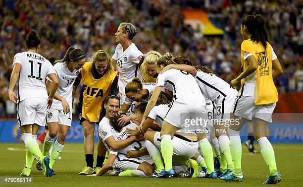 Kelly O'Hara of USA and her team mates celebrate after winning the FIFA Women's World Cup 2015 Semi Final match between USA and Germany at Olympic...
