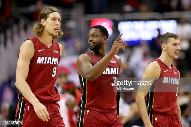 Kelly Olynyk Dwyane Wade and Goran Dragic of the Miami Heat celebrate after beating the Washington Wizards at Capital One Arena on October 18 2018 in...