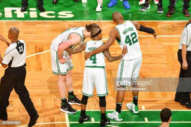 Kelly Olynyk Isaiah Thomas and Al Horford of the Boston Celtics huddle up during the game against the Chicago Bulls in Game Five of the Eastern...