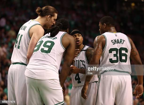 Kelly Olynyk Jae Crowder Isaiah Thomas and Marcus Smart of the Boston Celtics huddle against the Washington Wizards during Game Seven of the NBA...