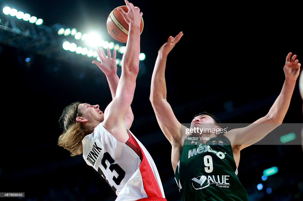 Kelly Olynyk of Canada handles the ball against Francisco Cruz of Mexico during a third place match between Canada and Mexico as part of the 2015 FIBA Americas Championship for Men at Palacio de los Deportes on September 12, 2015 in Mexico City, Mexico.