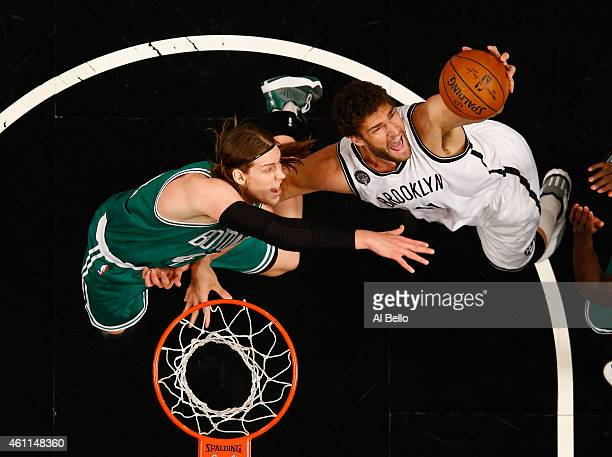 Kelly Olynyk of the Boston Celtics and Brook Lopez of the Brooklyn Nets battle for a rebound during their game at the Barclays Center on January 7...