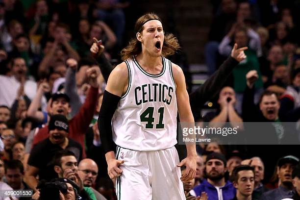 Kelly Olynyk of the Boston Celtics celebrates after a play in the second half against the Cleveland Cavaliers at TD Garden on November 14 2014 in...