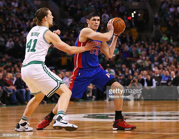 Kelly Olynyk of the Boston Celtics defends Ersan Ilyasova of the Detroit Pistons during the first quarter at TD Garden on January 6 2016 in Boston...