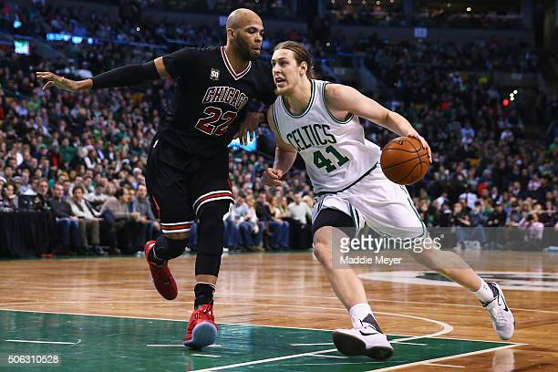 Kelly Olynyk of the Boston Celtics drives against Taj Gibson of the Chicago Bulls during the second quarter at TD Garden on January 22 2016 in Boston...
