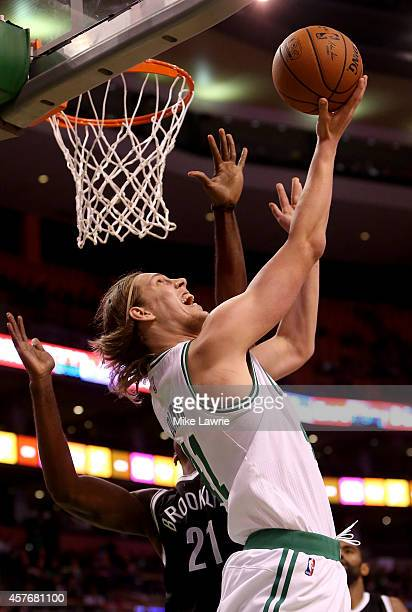 Kelly Olynyk of the Boston Celtics drives to the basket against Cory Jefferson of the Brooklyn Nets during a preseason game at TD Garden on October...