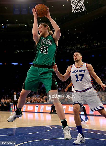 Kelly Olynyk of the Boston Celtics grabs the rebound as Lou Amundson of the New York Knicks stands by at Madison Square Garden on January 12 2016 in...