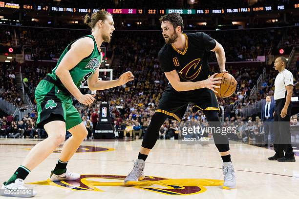 Kelly Olynyk of the Boston Celtics guards Kevin Love of the Cleveland Cavaliers during the first half at Quicken Loans Arena on December 29 2016 in...