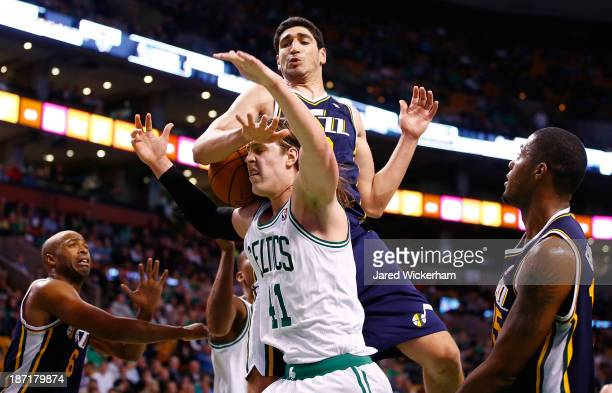 Kelly Olynyk of the Boston Celtics is fouled by Enes Kanter of the Utah Jazz in the second half against the Utah Jazz at TD Garden on November 6 2013...