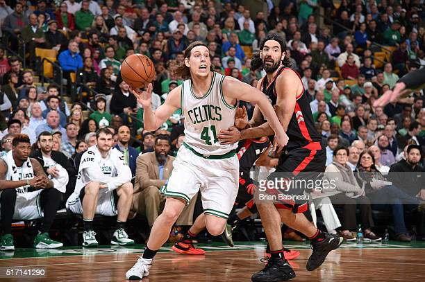 Kelly Olynyk of the Boston Celtics passes the ball against Luis Scola of the Toronto Raptors on March 23 2016 at the TD Garden in Boston...