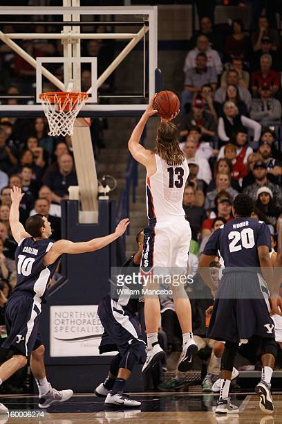 Kelly Olynyk of the Gonzaga Bulldogs attempts a goal during the game against the BYU Cougars at McCarthey Athletic Center on January 24 2013 in...