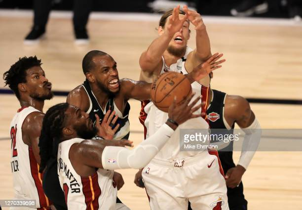 Kelly Olynyk of the Miami Heat and Khris Middleton of the Milwaukee Bucks fight for the ball during the fourth quarter in Game Two of the Eastern...