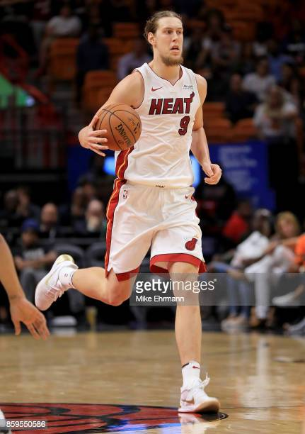 Kelly Olynyk of the Miami Heat brings the ball up during a preseason game against the Charlotte Hornets at American Airlines Arena on October 9 2017...