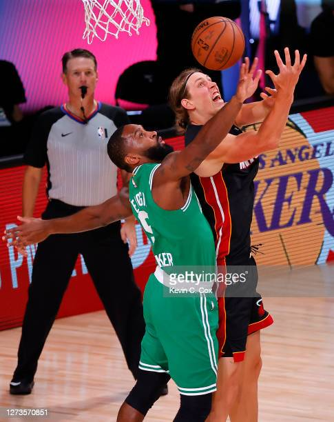 Kelly Olynyk of the Miami Heat draws a foul from Brad Wanamaker of the Boston Celtics during the fourth quarter in Game Three of the Eastern...