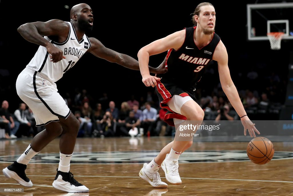Kelly Olynyk #9 of the Miami Heat drives to the basket against Quincy Acy #13 of the Brooklyn Nets in the first half during their Pre Season game at Barclays Center on October 5, 2017 in the Brooklyn Borough of New York City.