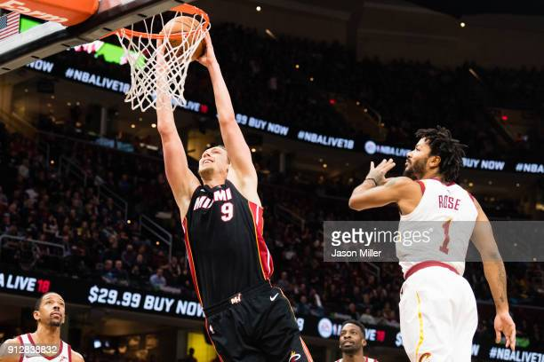 Kelly Olynyk of the Miami Heat dunks over Derrick Rose of the Cleveland Cavaliers during the first half at Quicken Loans Arena on January 31 2018 in...