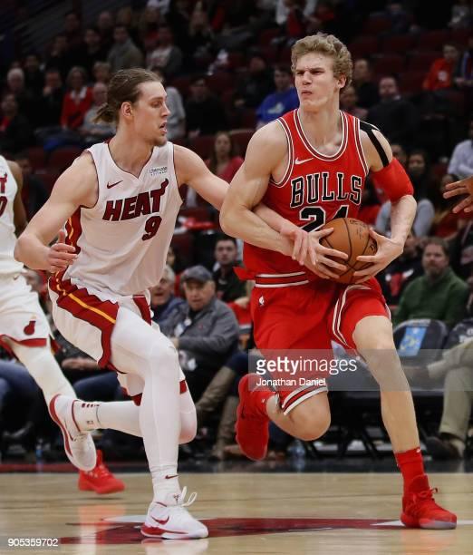 Kelly Olynyk of the Miami Heat fouls Lauri Markkanen of the Chicago Bulls at the United Center on January 15 2018 in Chicago Illinois The Bulls...