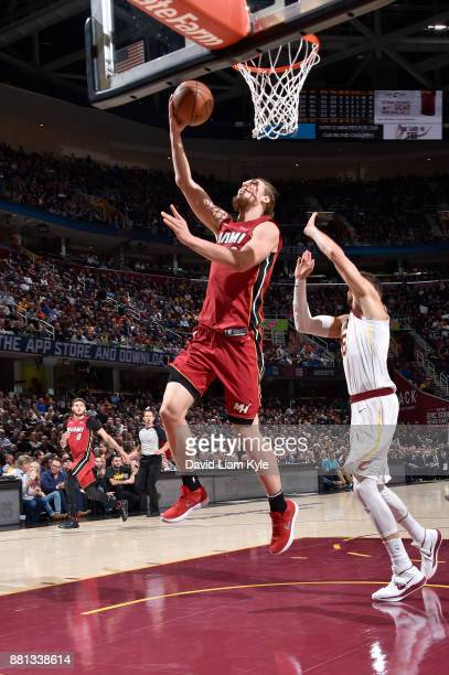 Kelly Olynyk of the Miami Heat goes to the basket against the Cleveland Cavaliers on November 28 2017 at Quicken Loans Arena in Cleveland Ohio NOTE...