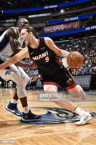 Kelly Olynyk of the Miami Heat handles the ball against the Orlando Magic during a preseason game on October 8 2017 at Amway Center in Orlando...