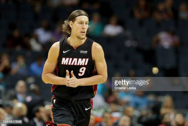 Kelly Olynyk of the Miami Heat reacts after a basket against the Charlotte Hornets during their game at Spectrum Center on October 2 2018 in...