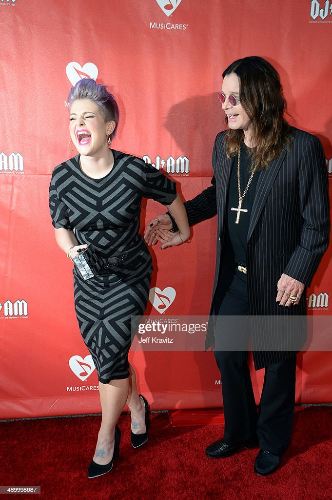 Kelly Osbourne and Ozzy Osbourne arrives at the 2014 10th annual MusiCares MAP Fund Benefit Concert at Club Nokia on May 12, 2014 in Los Angeles, California.
