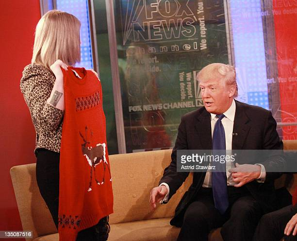 Kelly Osbourne gives Donald Trump a Christmas sweater during a live taping of 'FOX Friends' at FOX Studios on December 6 2011 in New York City