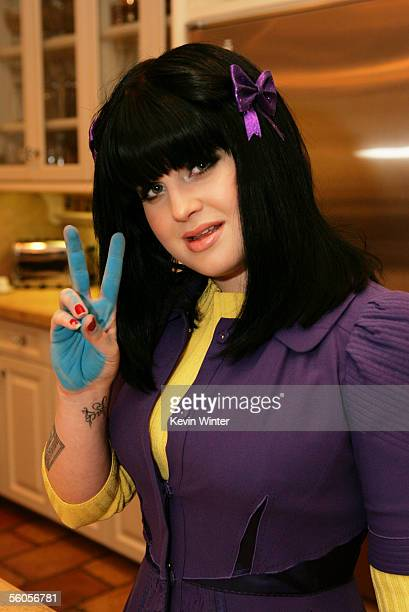 Kelly Osbourne gives the peace symbol her hand covered in ink having made her handprint in the official book as she records her contribution to the...