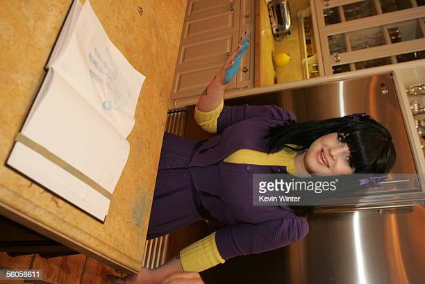 Kelly Osbourne makes her handprint in the official book as she records her contribution to the new disaster relief charity single a cover of the Sir...
