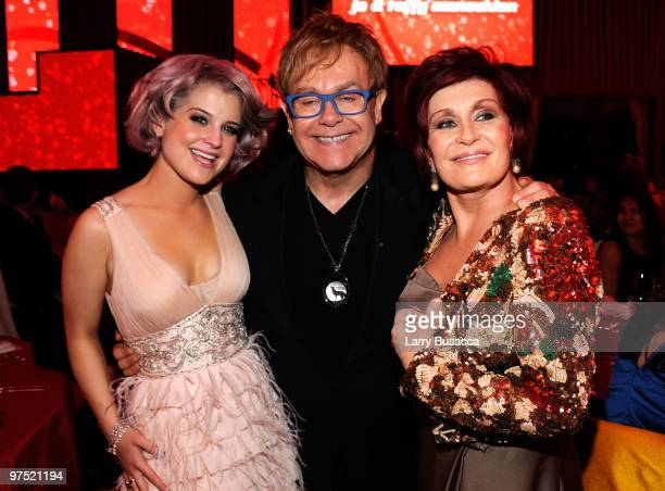 Kelly Osbourne, Musician Sir Elton John and Sharon Osbourne attend the 18th Annual Elton John AIDS Foundation Academy Award Party at Pacific Design...