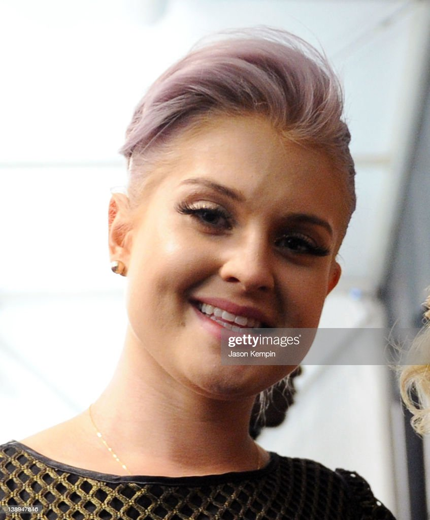 Kelly Osbourne poses backstage at the Badgley Mischka Fall 2012 fashion show during Mercedes-Benz Fashion Week at The Theatre at Lincoln Center on February 14, 2012 in New York City.