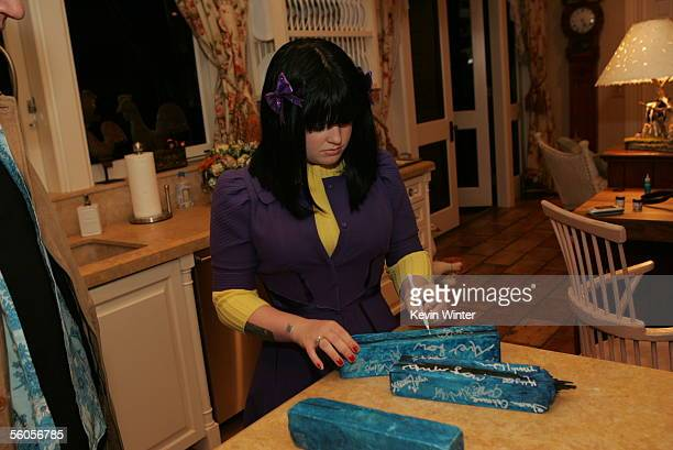 Kelly Osbourne signs blue bricks as she records her contribution to the new disaster relief charity single a cover of the Sir Eric Clapton ballad...