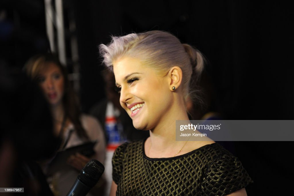 Kelly Osbourne speaks with the media backstage at the Badgley Mischka Fall 2012 fashion show during Mercedes-Benz Fashion Week at The Theatre at Lincoln Center on February 14, 2012 in New York City.