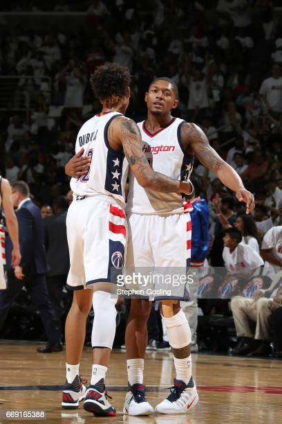 Kelly Oubre Jr #12 and Bradley Beal of the Washington Wizards are seen during the game against the Atlanta Hawks during the Eastern Conference...
