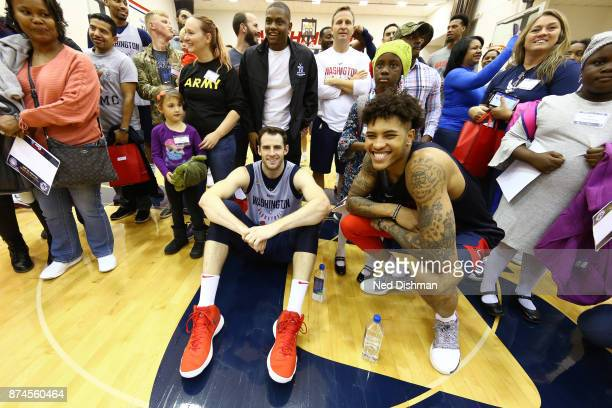 Kelly Oubre Jr #12 and Jason Smith of the Washington Wizards participate in an open practice for military veterans on November 10 2017 in Washington...