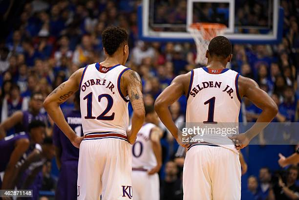 Kelly Oubre Jr #12 and Wayne Selden Jr #1 of the Kansas Jayhawks watch talk as they watch a free throw during a game against the Kansas State...