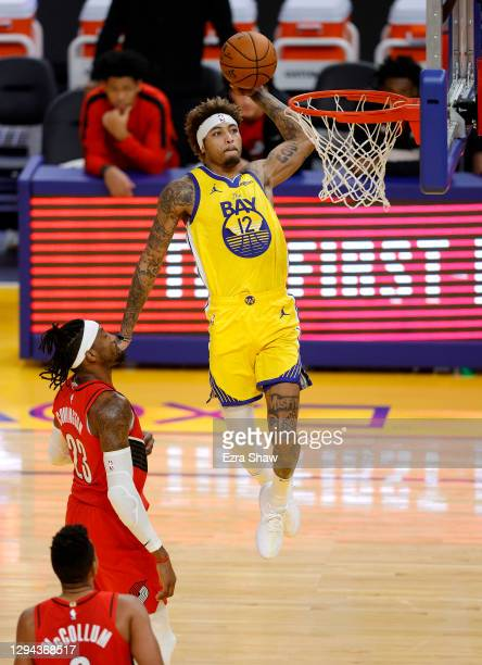 Kelly Oubre Jr. #12 of the Golden State Warriors goes up for a dunk on Robert Covington of the Portland Trail Blazers at Chase Center on January 03,...