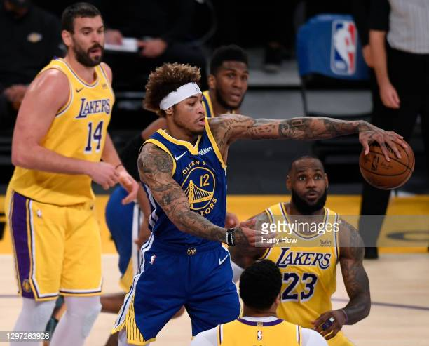 Kelly Oubre Jr. #12 of the Golden State Warriors grabs a rebound between LeBron James, Anthony Davis and Marc Gasol of the Los Angeles Lakers of the...