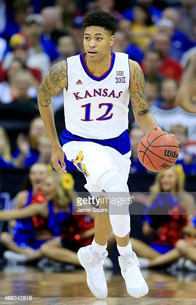 Kelly Oubre Jr #12 of the Kansas Jayhawks controils the ball against the Iowa State Cyclones in the first half during the championship game of the...
