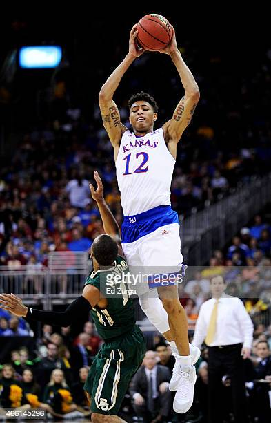 Kelly Oubre Jr #12 of the Kansas Jayhawks looks to pass over Lester Medford of the Baylor Bears in the second half during a semifinal game of the...