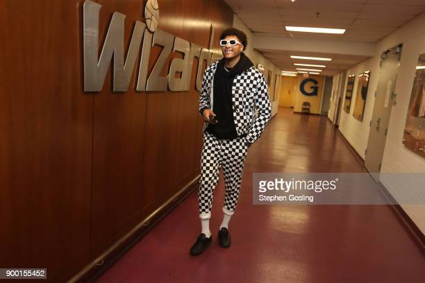 Kelly Oubre Jr #12 of the Washington Wizards arrives before the game against the Chicago Bulls on December 31 2017 at Capital One Arena in Washington...